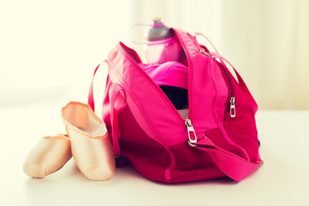 close up of pointe shoes and sports bag