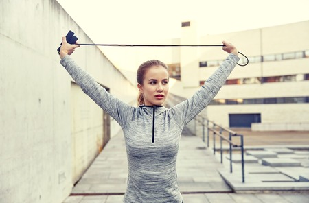 woman exercising with jump-rope outdoors Stock Photo