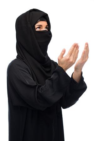 paranja: praying muslim woman in hijab over white Stock Photo