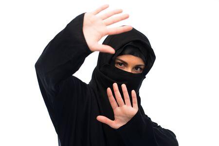 paranja: muslim woman in hijab showing stop sign