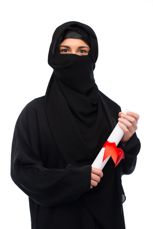paranja: muslim woman in hijab with diploma over white