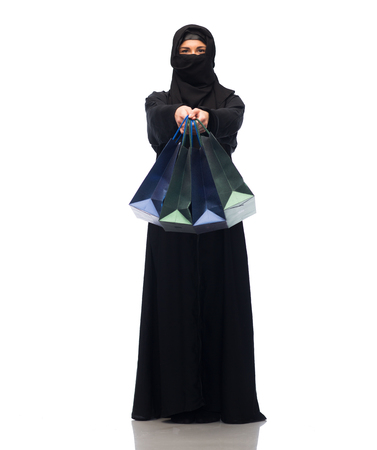 paranja: muslim woman in hijab with shopping bags Stock Photo
