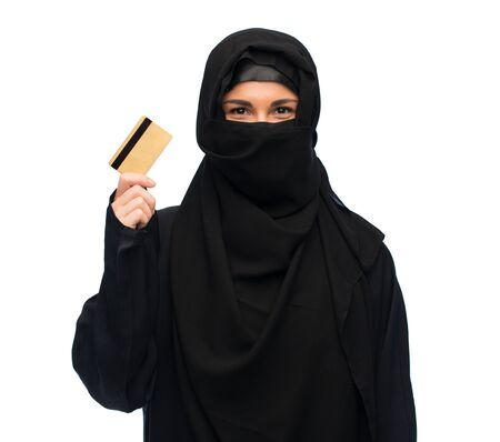 arabic currency: muslim woman in hijab with credit card over white
