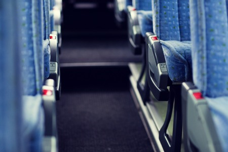 multiple objects: transport, tourism, road trip and equipment concept - travel bus interior and seats