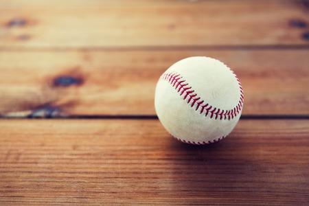 baseball stuff: close up of baseball ball on wooden floor