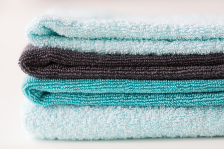 terrycloth: hygiene, fabric and textile concept - close up of stacked bath towels Stock Photo