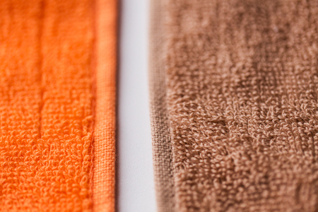 terrycloth: hygiene, fabric and textile concept - close up of bath towels