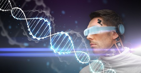 technological evolution: man with 3d glasses, sensors and dna molecule Stock Photo