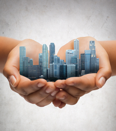 hands holding city over gray concrete background Stock Photo - 72799807