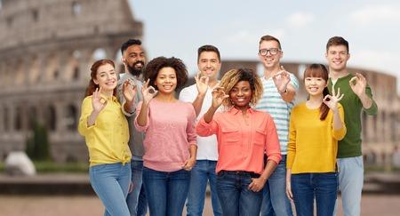 international people showing ok over coliseum