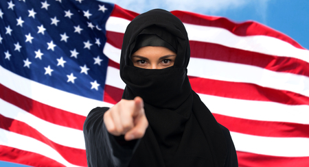 muslim woman in hijab pointing finger to you