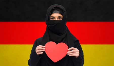 paranja: muslim woman in hijab holding red heart Stock Photo