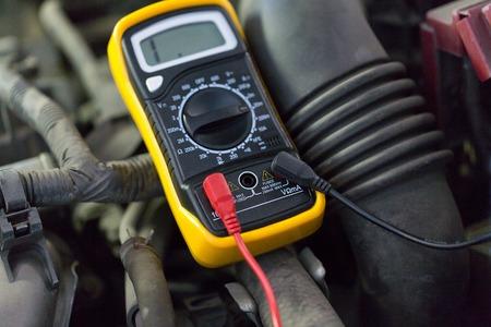 multimeter or voltmeter testing car battery Stock Photo