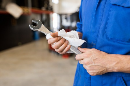 auto mechanic or smith with wrench at car workshop Reklamní fotografie