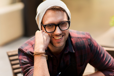 wristlet: happy smiling man in eyeglasses and hipster hat