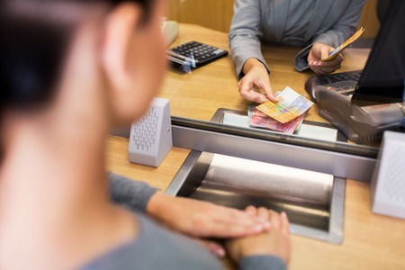 clerk counting cash money at bank office Stock Photo