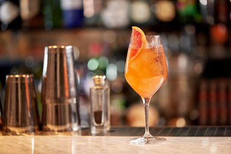 aperitive: glass of grapefruit cocktail at bar