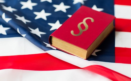 close up of american flag and lawbook