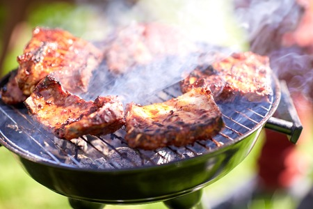 meat cooking on barbecue grill at summer party Stock Photo