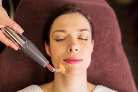 spa woman: woman having hydradermie facial treatment in spa Stock Photo