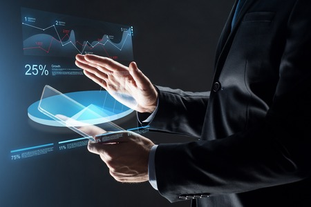 innovation concept: close up of businessman with transparent tablet pc
