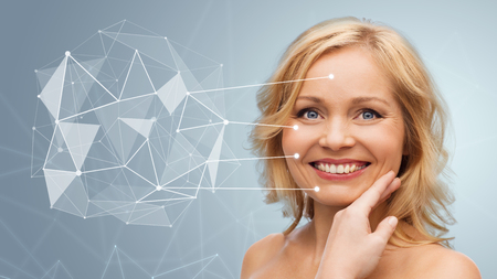 smiling woman with shoulders touching face