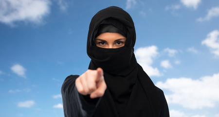 paranja: muslim woman in hijab pointing finger to you