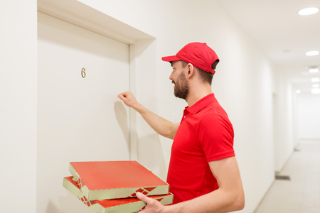 deliverer: delivery man with pizza boxes knocking on door