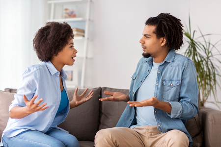 unhappy couple having argument at home 版權商用圖片 - 73173243