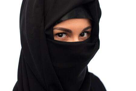 paranja: muslim woman in hijab over white background Stock Photo