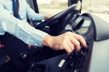 close up of driver driving passenger bus