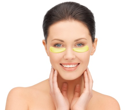 undereye: beautiful young woman face with under-eye patches Stock Photo
