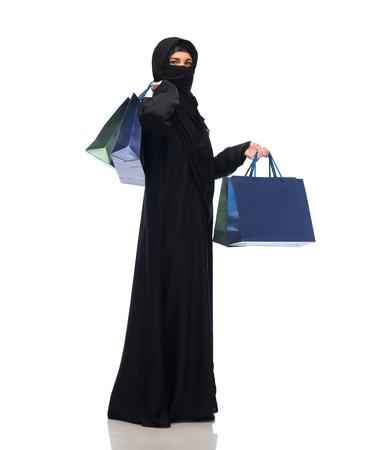 yashmak: muslim woman in hijab with shopping bags Stock Photo