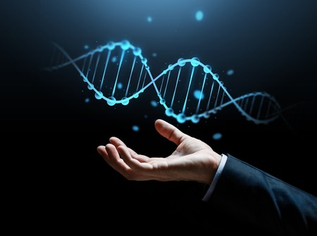 business, science, genetics and people concept - close up of businessman hand with dna molecule projection over dark background Stock Photo