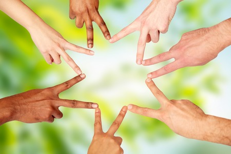 v shape: group of international people showing peace sign Stock Photo