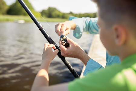 fishman: boy and grandfather with fishing rod on river Stock Photo