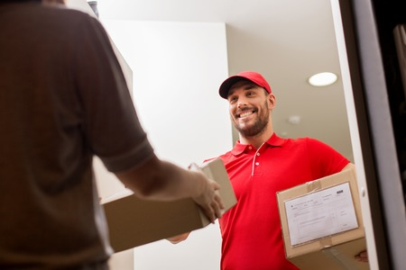 addressee: happy delivery man giving parcel box to customer