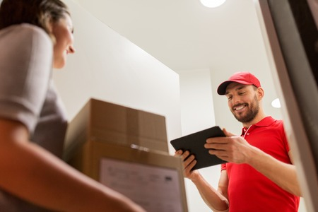addressee: deliveryman with tablet pc and customer with boxes