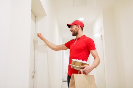 delivery man with coffee and food knocking on door Stock Photo