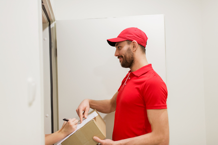 addressee: delivery man with box and customer signing form