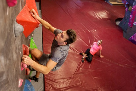 man and woman exercising at indoor climbing gym Stock Photo - 74023300