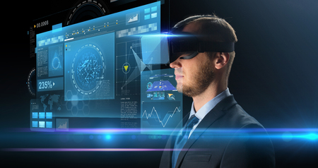 technology, people, cyberspace and augmented reality concept - young businessman with virtual headset or 3d glasses and screen projection over black background