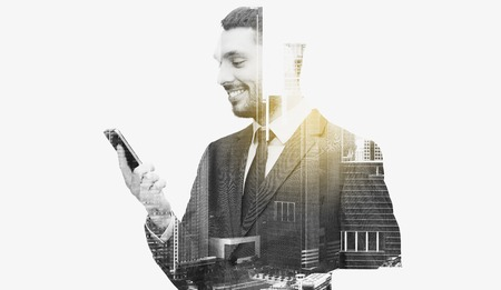 business, technology and people concept - smiling businessman texting on smartphone over city buildings and double exposure effect