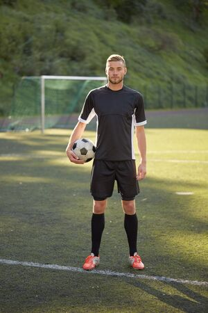 sport, football training and people - soccer player with ball on field Stock Photo