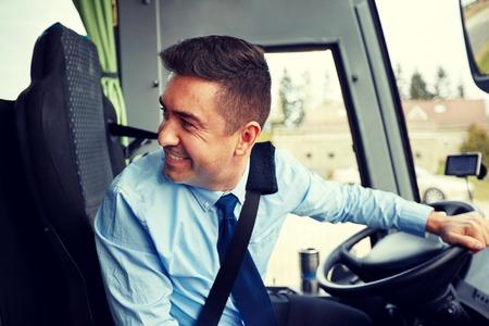 intercity: happy driver driving intercity bus Stock Photo