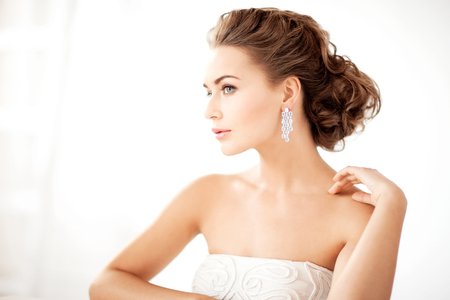 woman wearing shiny diamond earrings photo
