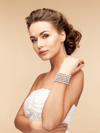 woman with pearl earrings and bracelet photo