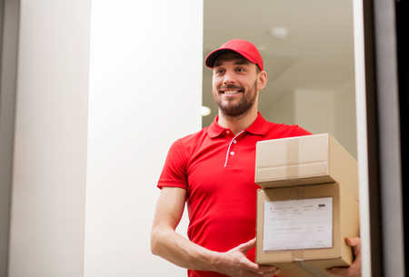 deliverer: delivery man with parcel boxes at customer door