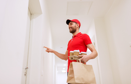 deliverer: delivery man with coffee and food ringing doorbell