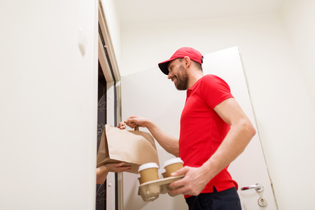 deliverer: man delivering coffee and food to customer home